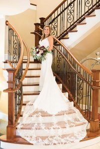 Bride posing on staircase