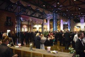 Guests around bride and groom on dancefloor