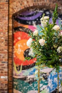Flowers infront of painted brick wall