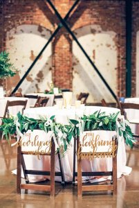 Seats for the bride and groom at dinner table