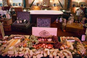 Meats, cheeses, and bread on table