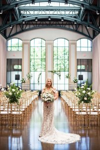 Bride posing infront of seating area