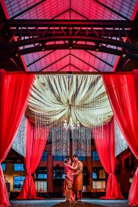 Bride and groom dancing under overhang