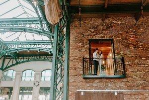 Bride and groom posing on balcony
