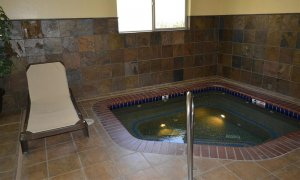 corner hot tub with lounger chair