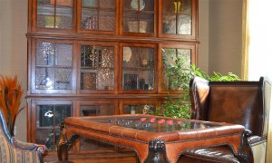 display cabinet near chess tablea nd chairs