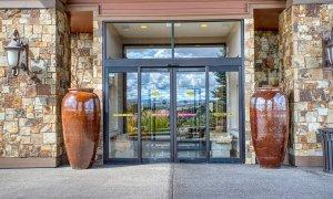 Front door between large decorative pots