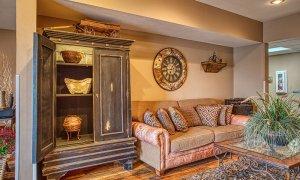 Decorative wardrobe next to couch