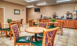 Tables, chairs, and breakfast bar in dining room