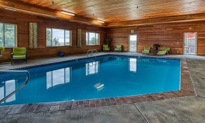Indoor swimming pool with lounge chairs