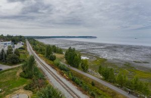 Train tracks next to ocean coastline