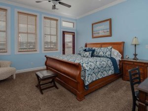 King-sized bed with footstool and end of bed
