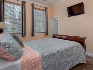Bed facing wall-mounted television