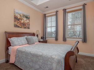 Queen-sized bed in bedroom