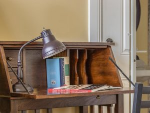 Lamp and book on desktop