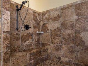 Showerhead in tiled shower
