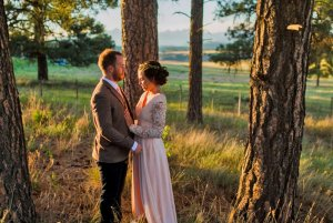 bride and groom at sunset in the forest