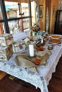 Decorated table with burlap and vintage boxes