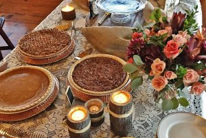 pies on a buffery table with flowers