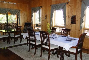 Large dining tables and chairs set up in dining room