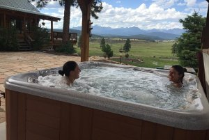 Two people sitting in hottub