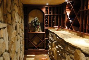 Stone countertop in hallway with wineracks
