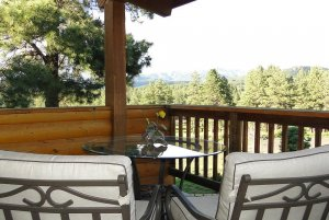 Reclining chairs and round glass table on outdoor balcony