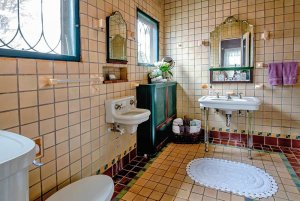 Tile bathroom with toile and sinks
