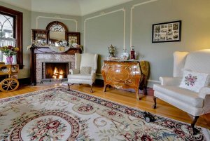 Sitting room with plush chairs and oriental rug
