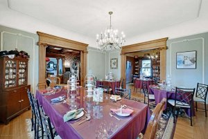 Set dining tables under chandelier in dining room