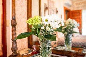 Flowers in glass vase set on vanity