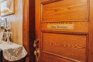 Doorway with Lady Genevieve nameplate