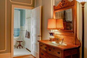 Vanity and lamp next to bathroom doorway