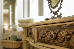 Decorated wood drawer in bathroom