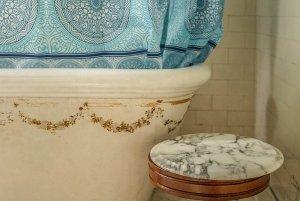 Stool next to bathtub in bathroom