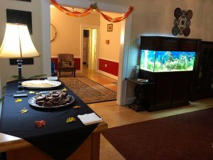 Dessert table across from fish tank in dining room
