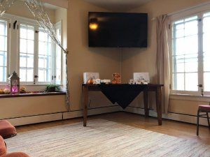 Television above table in corner of room