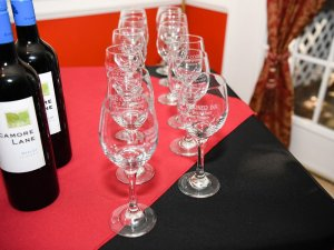 Wine glasses on a table by wine