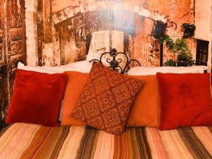 Decorative pillows lined up on bed headboard