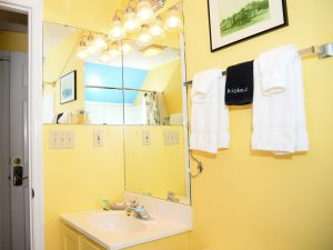 Wall mirrors in corner above sink