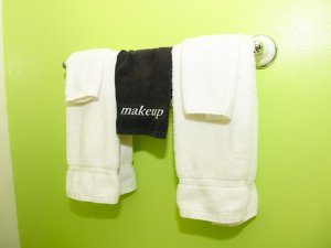 Handtowels hung on towel rack on bathroom wall