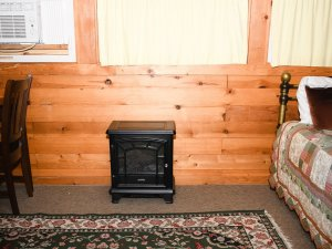 Gas fireplace under window next to daybed