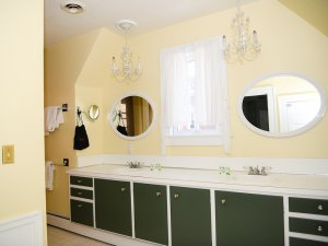 Long countertop in bathroom with 2 sinks and mirrors
