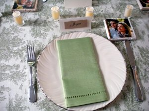 Seating at table set with silverware, namecard, and handkerchief