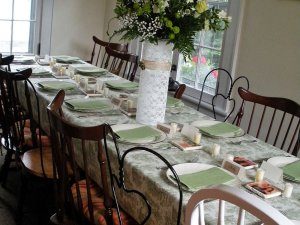 Place settings lined up along dining table