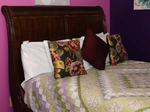 Quilted blanket with pillows on a bed