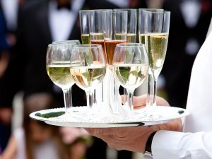 Tray of champaigne glasses being held by waiter