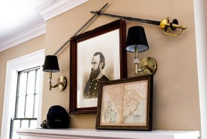 Crossed Rapiers, Portrait of historical figure, and map above fireplace mantle