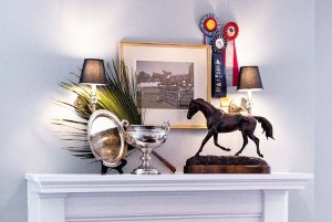 horse decor on shelf