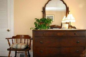 Wooden chair near dresser